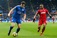 Harry Maguire of Leicester City contends with Jordan Ayew of Swansea during the Premier League match between Leicester City and Swansea City at the King Power Stadium, Leicester, England, UK. Saturday 03 February 2018