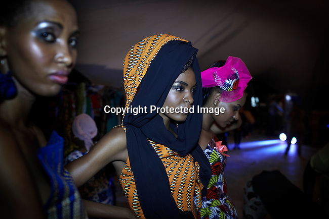 DAR ES SALAAM, TANZANIA - DECEMBER 7: Models line up backstage before fashion shows at Swahili Fashion week on December 7, 2013 in Dar Es Salaam, Tanzania. The yearly fashion week show local Swahili designers work and invited African designers. (Photo by: Per-Anders Pettersson)