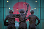"© Joel Goodman - 07973 332324 . 7 November 2013 . Sir Matt Busby Way , Manchester , UK . A poppy stencilled on to the front of Manchester United 's stadium at Old Trafford today , 7th November 2013 , as viewed from Sir Matt Busby Way through "" The United Trinity "" statue . Photo credit : Joel Goodman"