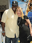 Michael Clarke Duncan & Christina Applegate at the Warner Bros. Pictures World Premiere of Cats & Dogs Revenge of Kitty Galore held at The Grauman's Chinese Theatre in Hollywood, California on July 25,2010                                                                               © 2010 Debbie VanStory / Hollywood Press Agency