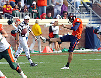 Oct 30, 2010; Charlottesville, VA, USA; Virginia Cavaliers punter Jimmy Howell (8) kicks the ball during the game against the Miami Hurricanes at Scott Stadium. Virginia won 24-19.  Mandatory Credit: Andrew Shurtleff-US PRESSWIRE