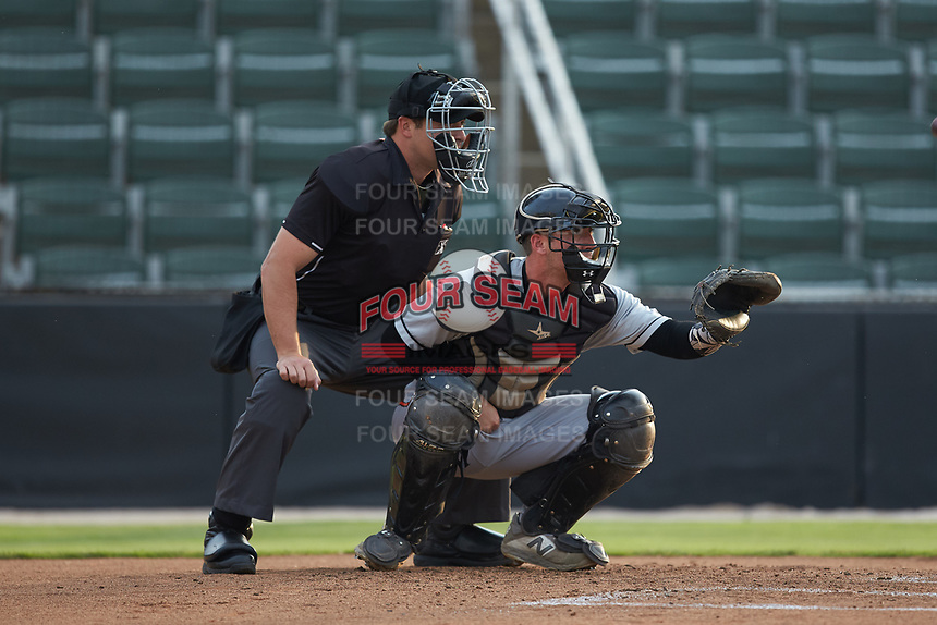 Delmarva Shorebirds catcher Ben Breazeale (12) sets a target as home plate umpire Colin Baron looks on during the game against the Kannapolis Intimidators at Kannapolis Intimidators Stadium on June 3, 2019 in Kannapolis, North Carolina. The Shorebirds defeated the Intimidators 5-3. (Brian Westerholt/Four Seam Images)