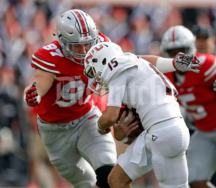 Ohio State Buckeyes defensive lineman Joey Bosa (97) tackles Northern Illinois Huskies punter Jake Ambrose (15) on a dropped punt in the 2nd quarter of their game at Ohio Stadium on September 19, 2015.  (Dispatch photo by Kyle Robertson)