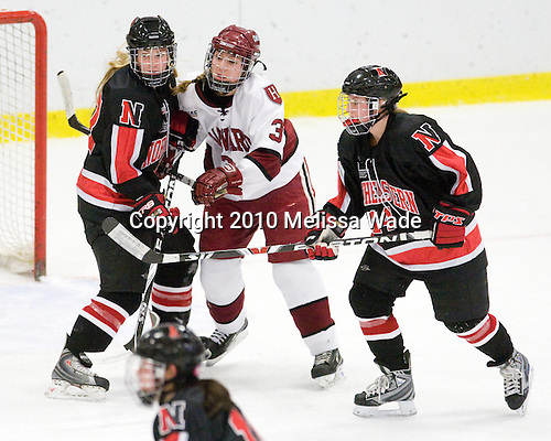 Ginny Berg (NU - 17), Liza Ryabkina (Harvard - 3), Casey Pickett (NU - 14) - The Harvard University Crimson defeated the Northeastern University Huskies 1-0 to win the 2010 Beanpot on Tuesday, February 9, 2010, at the Bright Hockey Center in Cambridge, Massachusetts.