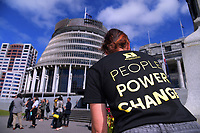 Ann Cloet (Action Station) gathers flower after the petition presentation. Semi-automatic weapons ban and firearms advertising regulation petitions at Parliament in Wellington, New Zealand on Thursday, 21 March 2019. Photo: Dave Lintott / lintottphoto.co.nz