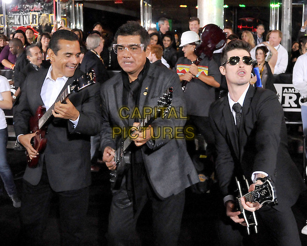 LA Mayor ANTONIO VILLARAIGOSA, GEORGE LOPEZ & ROBIN THICKE .The Hard Rock Cafe Hollywood's grand opening party in Hollywood, California, USA..October 21st, 2010.half length black jacket grey gray sunglasses shades guitar .CAP/RKE/DVS.©DVS/RockinExposures/Capital Pictures.