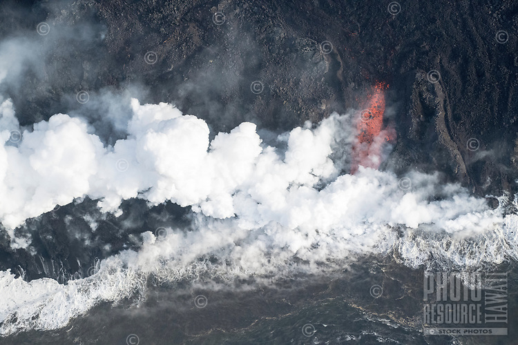 May 2018: Lava from the Kilauea Volcano eruption meets the Pacific Ocean by what was once Kapoho Bay, Big Island of Hawai'i.