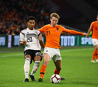Serge Gnabry (Deutschland Germany) gegen Frenkie de Jong (Niederlande) - 24.03.2019: Niederlande vs. Deutschland, EM-Qualifikation, Amsterdam Arena, DISCLAIMER: DFB regulations prohibit any use of photographs as image sequences and/or quasi-video.