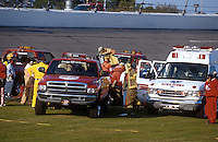 Dale Earnhardt Crash Frame 11.Rescue personel prepare to remove Earnhardt from his car..NASCAR Winston Cup Daytona 500 18 Feb.2001 Daytona International Speedway, Daytona Beach,Florida,USA .© F. Peirce Williams .photography 2001...F.Peirce Williams Photography.P.Box 455 Eaton, OH 45320.317.358.7326  fpwp@mac.com