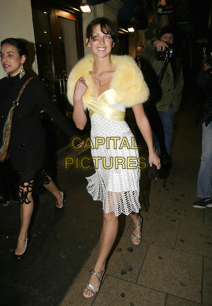 "MARGOT STILLEY.""A Life in Theatre"" press night,.Apollo Theatre, Shaftesbury Avenue, London,.February 2nd 2005..full length yellow fur shrup cape wrap shawl ribbon bow white dress crochet tassled fringed.Ref: AH.www.capitalpictures.com.sales@capitalpictures.com.©Capital Pictures."