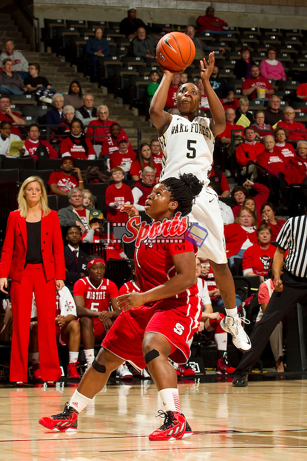 Chelsea Douglas (5) of the Wake Forest Demon Deacons takes a jump shot over Myisha Goodwin-Coleman (1) of the North Carolina State Wolfpack at the LJVM Coliseum on January 6, 2013 in Winston-Salem, North Carolina.  The Demon Deacons defeated the Wolfpack 69-56.    (Brian Westerholt/Sports On Film)