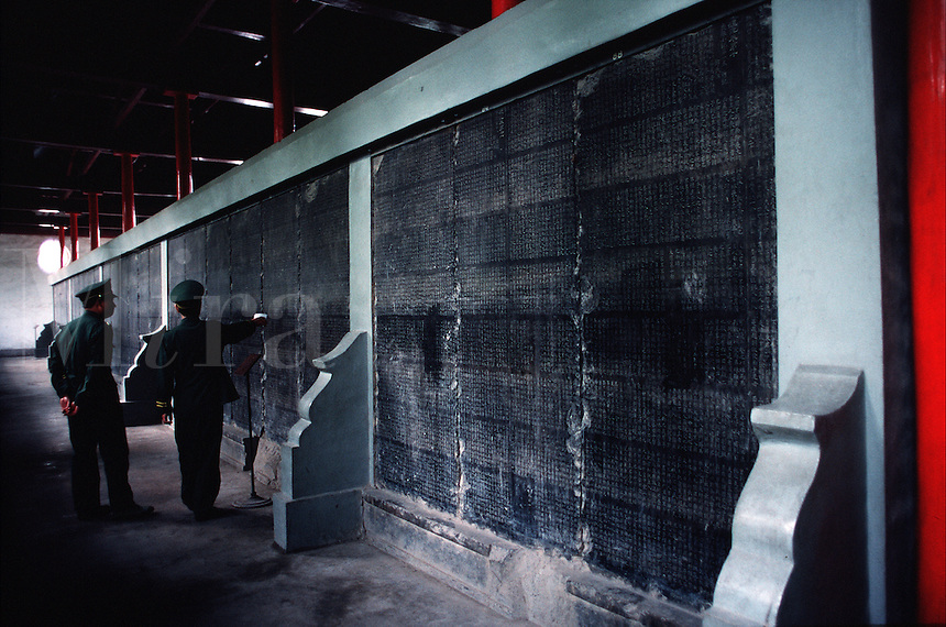 People look at granite law tablets in the Provincial Art Museum. Xian, China.