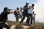 Israeli border police arrest a Palestinian villager from Oref village during clashes with Jewish settlers after Israeli settlers attacked villages near Nablus City 30 April 2013. Reports state that the clashes occured after an Israeli settler was stabbed to death by a Palestinian man. Israeli media reported that the Palestinian attacker took the settlers' weapon and began firing at a nearby Israeli border guard force, who returned fire, wounding the attacker. Photo by Nedal Eshtayah