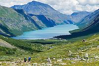 Hikers above lake Gjende in Norway's Jotunheimen national park