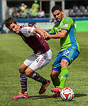 Seattle Sounders Lamar Neagle, right,  defends against Colorado Rapids Nathan Sturgis during an MLS match on April 26, 2014 in Seattle, Washington. Neagle scored a goal as Seattle Sounders beat the Colorado Rapids 4-1.  Jim Bryant Photo. ©2014. All Rights Reserved.
