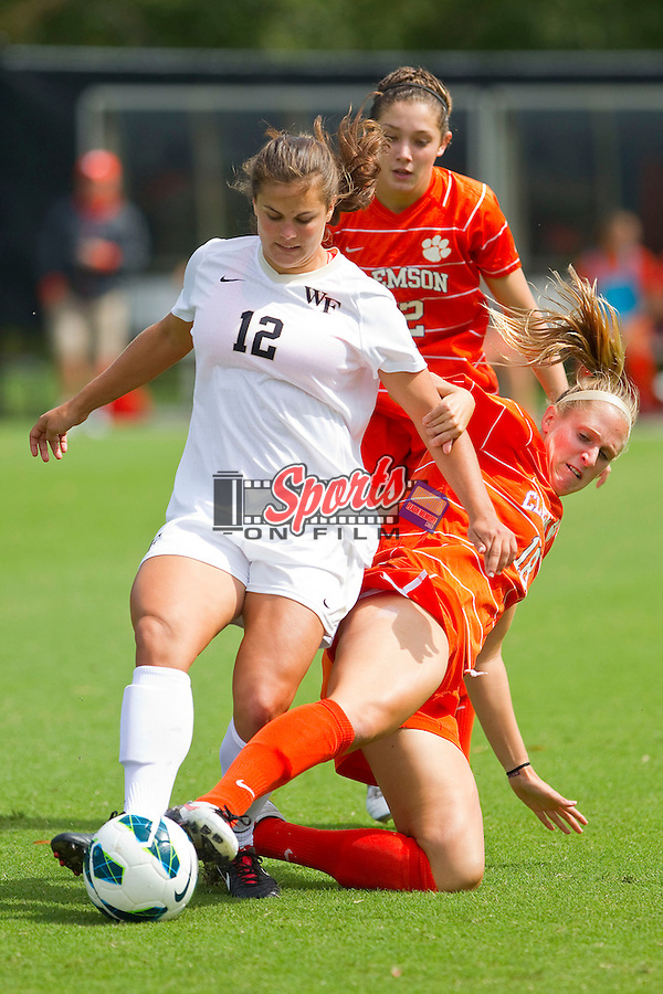 Katie Stengel (12) of the Wake Forest Demon Deacons tries to keep the ball away from Heather Marik (18) and Katelyn Reeve (12) of the Clemson Tigers at Spry Soccer Stadium on September 30, 2012 in Winston-Salem, North Carolina.  The Demon Deacons defeated the Tigers 4-0.  (Brian Westerholt / Sports On Film)