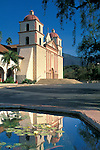 Front of the Historic Mission Santa Barbara Chapel reflected in fountain water, Santa Barbara, California