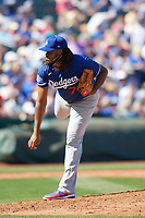 Los Angeles Dodgers pitcher Kenley Jansen (74) delivers a pitch during a Cactus League Spring Training game against the Texas Rangers on March 8, 2020 at Surprise Stadium in Surprise, Arizona. Rangers defeated the Dodgers 9-8. (Tracy Proffitt/Four Seam Images)