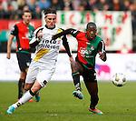 Nederland, Nijmegen, 2 december 2012.Eredivisie .Seizoen 2012-2013.N.E.C.-NAC Breda.Leroy George (r.) van N.E.C. en Nemanja Gudelj (l.) van NAC Breda strijden om de bal.