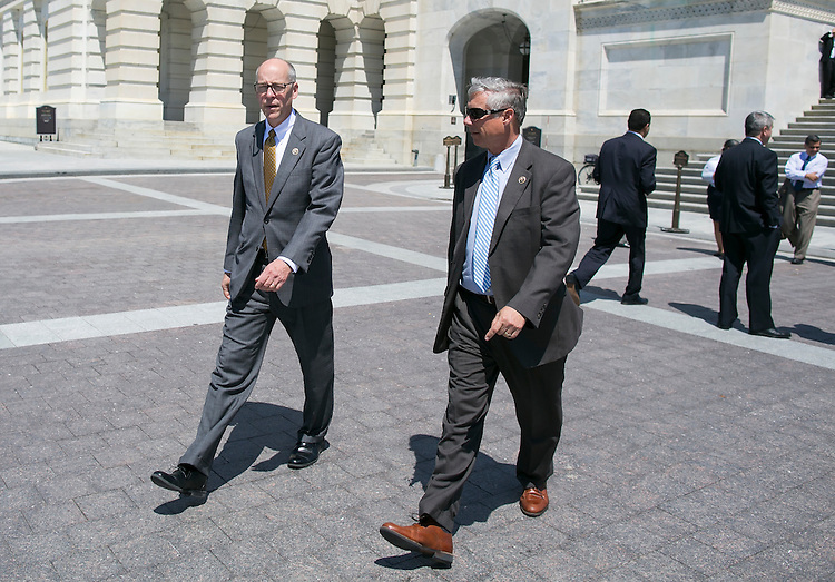 UNITED STATES - JUNE 10 - Rep. Greg Walden, R-Ore., left, and Rep. Fred Upton, R-Mich., leave the House Chambers after the U.S. House of Representatives voted in favor of the 21st Century Cures Act on Capitol Hill in Washington, Friday, July 10, 2015. (Photo By Al Drago/CQ Roll Call)