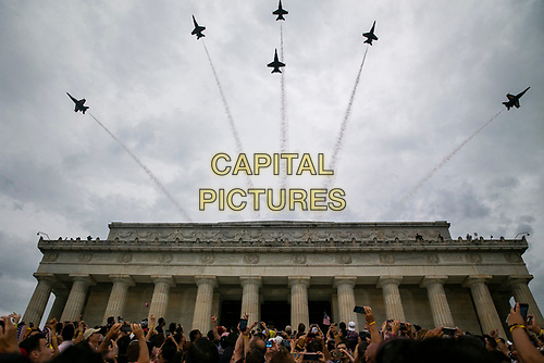 "Attendees cheer as Blue Angel fighter jets fly overheard as U.S. President Donald Trump speaks during the Fourth of July Celebration 'Salute to America' event in Washington, D.C., U.S., on Thursday, July 4, 2019. The White House said Trump's message won't be political -- Trump is calling the speech a ""Salute to America"" -- but it comes as the 2020 campaign is heating up. <br /> h<br /> CAP/MPI/CNP<br /> ©CNP/MPI/Capital Pictures"