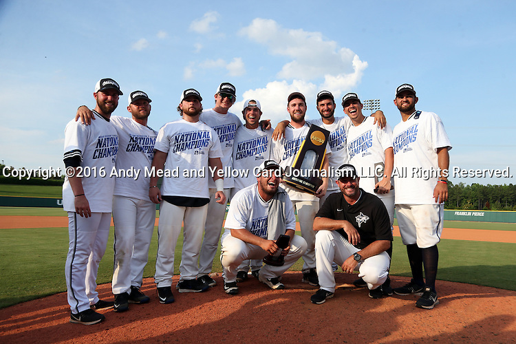 04 June 2016: Nova Southeastern head coach Greg Brown (in black) poses with his seniors. The Nova Southeastern University Sharks played the Millersville University Marauders in Game 14 of the 2016 NCAA Division II College World Series  at Coleman Field at the USA Baseball National Training Complex in Cary, North Carolina. Nova Southeastern won the game 8-6 and clinched the NCAA Division II Baseball Championship.