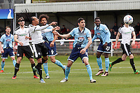 Ricky Modeste of Dover (3rd left) heads wide during the Vanarama National League match between Dover Athletic and Grimsby Town at the Crabble Athletic Ground, Dover, England on 16 April 2016. Photo by Tony Fowles/PRiME Media Images.