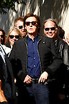 LOS ANGELES, CA - FEB 9: Paul McCartney; Neil Young at a ceremony where Paul McCartney is honored with a star on The Hollywood Walk Of Fame on February 9, 2012 in Los Angeles, California