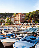 CROATIA, Hvar, Dalmatian coast, boats moored in Hvar Island with shops along the marina in the background.