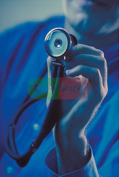physician holding stethoscope