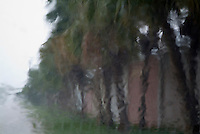 Heavy rain falling on a car windscreen during a rainstorm in Cuba.