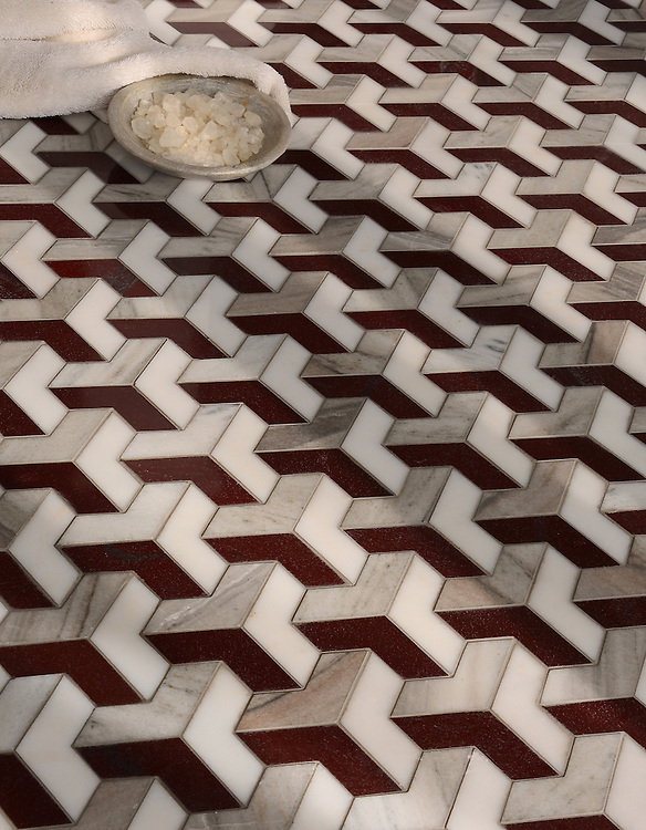 Francois Grand, a waterjet mosaic, shown in polished Red Lake, polished Afyon White, and honed Horizon, is part of the Illusions® collection by New Ravenna.