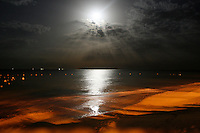 Full moon night at red sand beach.