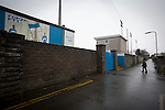 A solitary spectator makes his way towards the turnstiles before Port Talbot Town played host to Caerau Ely in a Welsh Cup fourth round tie at the Genquip Stadium, formerly known as Victoria Road. Formed by exiled Scots in 1901 as Port Talbot Athletic, they competed in local and regional football before being promoted to the League of Wales  in 2000 and changing their name to the current version a year later. Town won this tie 3-0 against their opponents from the Welsh League, one level below the welsh Premier League where Port Talbot competed, watched by a crowd of 113.