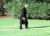 United States President Bill Clinton walks alone to the Oval Office of the White House in Washington, D.C. after he returned from Camp David on February 1, 1999..Credit: Ron Sachs / CNP