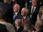 United States Vice President Mike Pence, left, and US Senate Majority Leader Mitch McConnell (Republican of Kentucky), lead their colleagues into the US House chamber prior to US President Donald J. Trump delivering his second annual State of the Union Address to a joint session of the US Congress in the US Capitol in Washington, DC on Tuesday, February 5, 2019.<br /> Credit: Alex Edelman / CNP