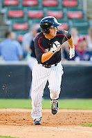 Justin Jirschele (6) of the Kannapolis Intimidators hustles down the first base line against the Hagerstown Suns at CMC-Northeast Stadium on May 17, 2013 in Kannapolis, North Carolina.  The Suns defeated the Intimidators 9-7.   (Brian Westerholt/Four Seam Images)