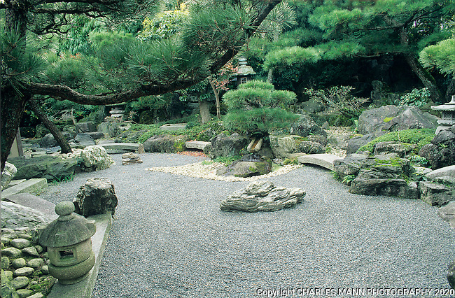 This Zen garden includes many of the traditoinal elemensts of a Japanese garden including a dry water element, pine trees and fountains.