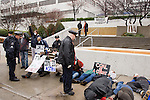 Police officers ask activists participating in a DIe In to clear the sidewalk. In the background, the TVA Headquarters, Knoxville, Tennessee. Mountain Justice Spring Break, March 14, 2009 (©Robert vanWaarden ALL RIGHTS RESERVED)