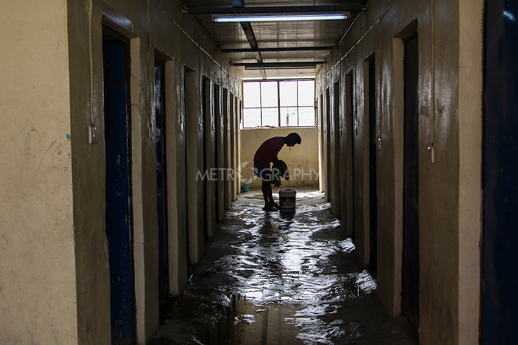 10/10/2014 -- Kirkuk, Iraq -- A Bangladeshi worker washes his clothes in the bathroom in the garage where they live on Kornish street.