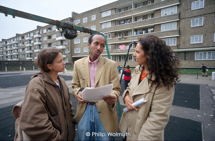 Community worker Abdullah Mohamed consults with two residents on the Guinness Trust's Loughborough Park Estate in Brixton, South London.