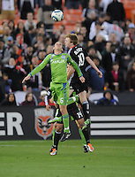 Seattle Sounders midfeidler Osvaldo Alonso (6) heads the ball against DC United Dax McCarty (10)   DC United defeated The Seattle Sounders 2-1 at  RFK Stadium, Wednesday May 4, 2011.