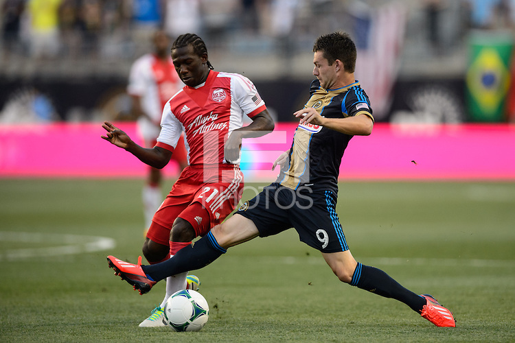 Jack McInerney (9) of the Philadelphia Union challenges Diego Chara (21) of the Portland Timbers for the ball. The Philadelphia Union and the Portland Timbers played to a 0-0 tie during a Major League Soccer (MLS) match at PPL Park in Chester, PA, on July 20, 2013.