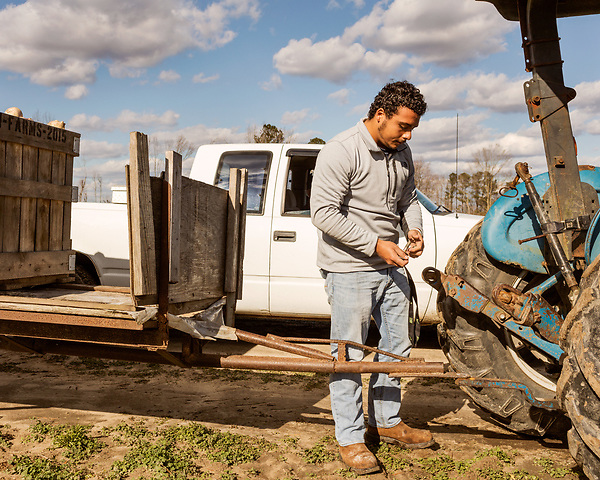 December 30, 2016. Rose Hill, North Carolina.<br /> <br /> John Dunn unhitches a trailer full of rutabagas from a tractor on a field owned by Cottles Organics, a farm where he has worked since he was a child.<br />  <br /> John Dunn, age 19, is currently a freshman at NC State University and is the first person in his family to go to college. With a combination of grants, loans, help from his grandfather and weekend farm work, Dunn hopes to find finish college and find a career in agriculture.<br /> <br />  Colleges and universities, which are always trying to pinpoint an under-served and sometimes underprivileged populations of students, have noted a decline in students from rural areas of the country. There are various efforts underway in colleges and universities to identify more of these kids and get them enrolled.