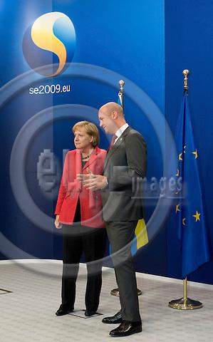 Brussels-Belgium - September 17, 2009 -- Informal European Council, EU-summit under Swedish Presidency; here, Fredrik REINFELDT (ri), Prime Minister of Sweden,  welcomes Angela MERKEL (le), Federal Chancellor of Germany -- Photo: Horst Wagner / eup-images