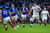 10th February 2019, Twickenham Stadium, London, England; Guinness Six Nations Rugby, England versus France; Owen Farrell of England kicks the ball past Romain Ntamack of France