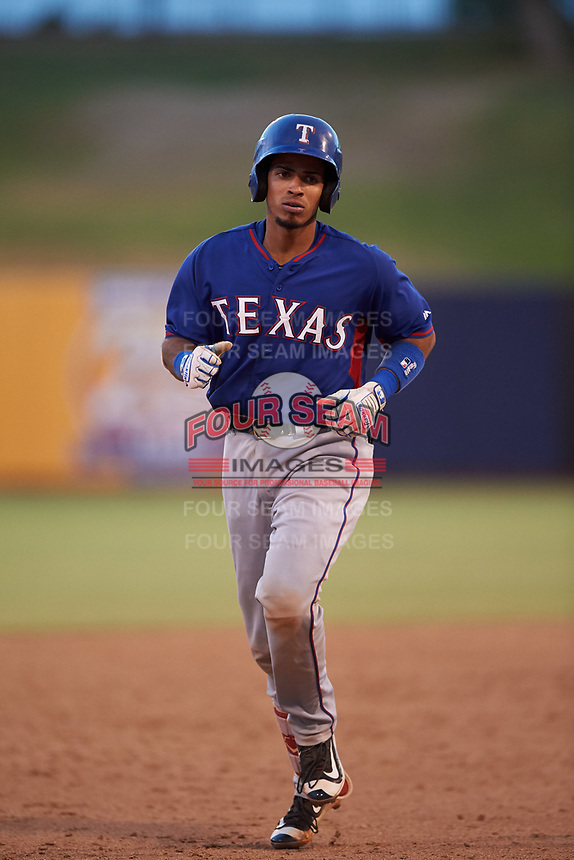 AZL Rangers Randy Florentino (1) rounds the bases after hitting a home run during an Arizona League game against the AZL Brewers Blue on July 11, 2019 at American Family Fields of Phoenix in Phoenix, Arizona. The AZL Rangers defeated the AZL Brewers Blue 5-2. (Zachary Lucy/Four Seam Images)