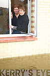 Carmel Sheehan and Rachel O'Gorman, Ballyspillane, Killarney, look out the window of their flooded home on Monday afternoon.