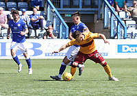 Connor Murray fouling Jamie Semple in the SPFL Betfred League Cup group match between Queen of the South and Motherwell at Palmerston Park, Dumfries on 13.7.19.