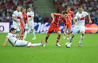 FUSSBALL  EUROPAMEISTERSCHAFT 2012   VORRUNDE Polen - Russland             12.06.2012 Sebastian Boenisch (li) und Eugen Polanski (re, beide Polen) gegen Alan Dzagoev (Mitte, Russland)